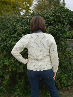 Traditional Lily of the Valley pattern jumper using Wonnacott Organic Wool. Design: Tricia Holman. Model: Louise Webb.